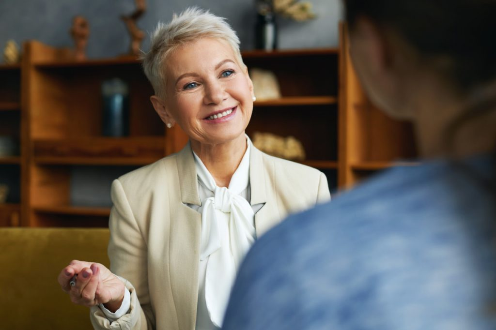 Woman Interviewing Applicant For Job With National 360