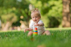 baby girl white sandpit green grass playing pyramid 98296 1184